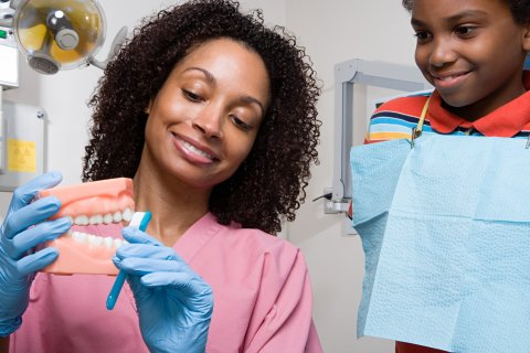 a dental assistant with her patient