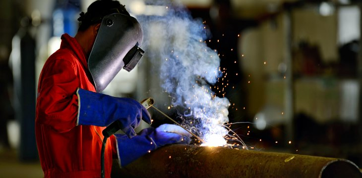 a trained welder at work