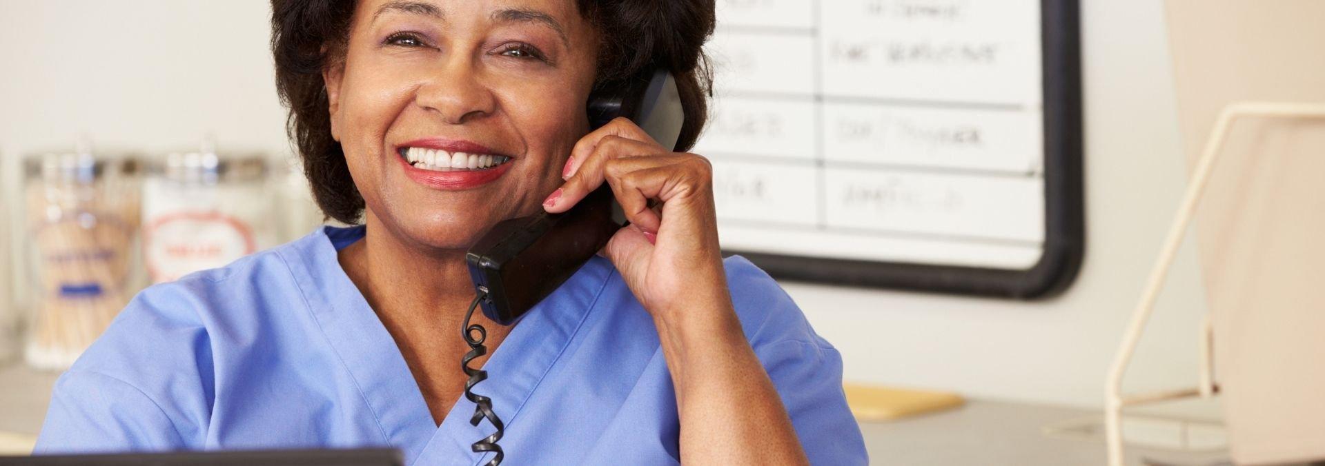 health unit coordinator on phone