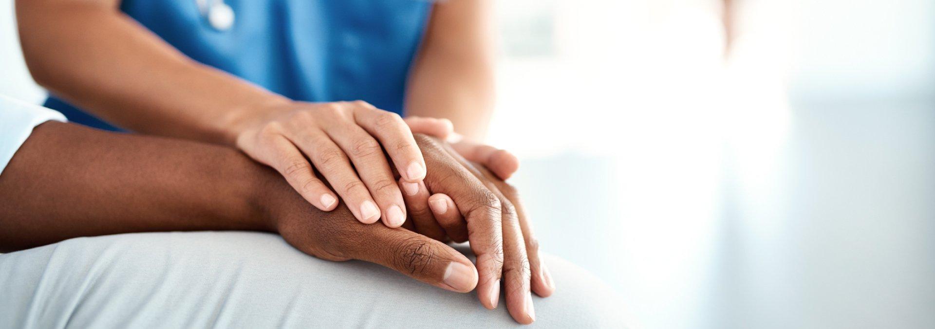 Woman Comforting Patient