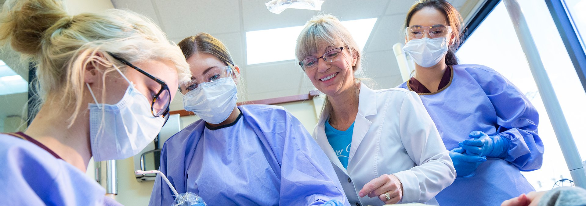 dental assisting teacher demonstrates