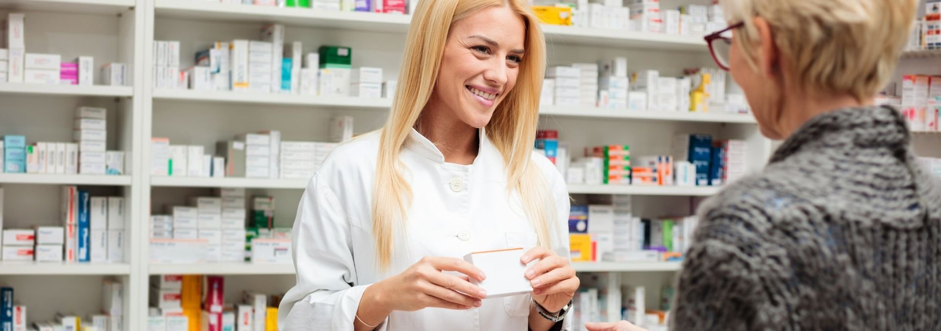pharmacy technician with customer
