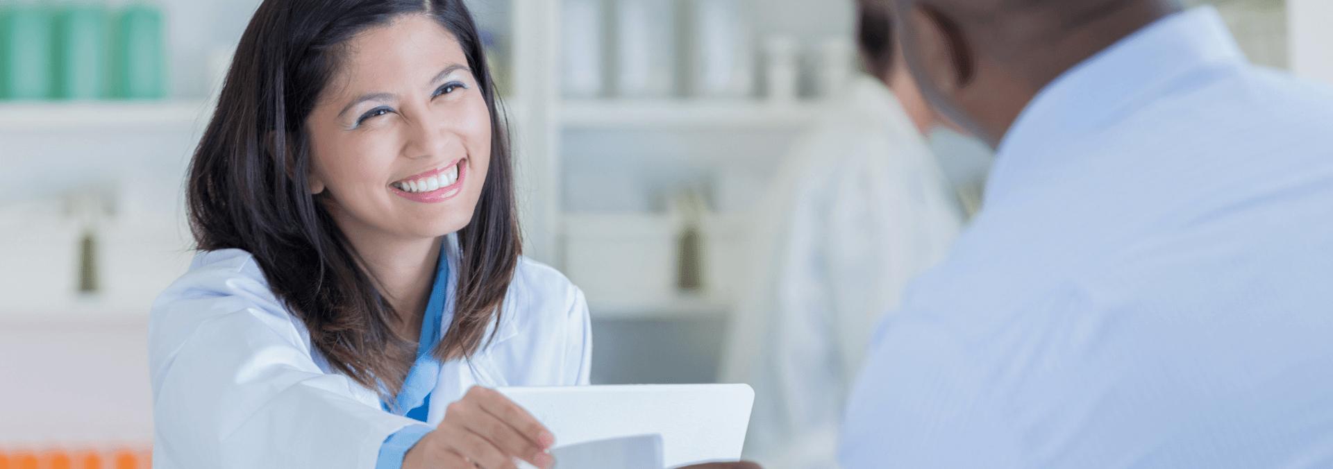 pharmacy technician providing customer service
