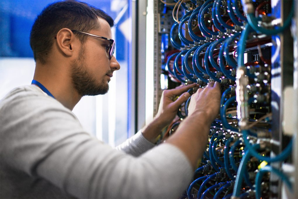 IT worker troubleshooting a networking system