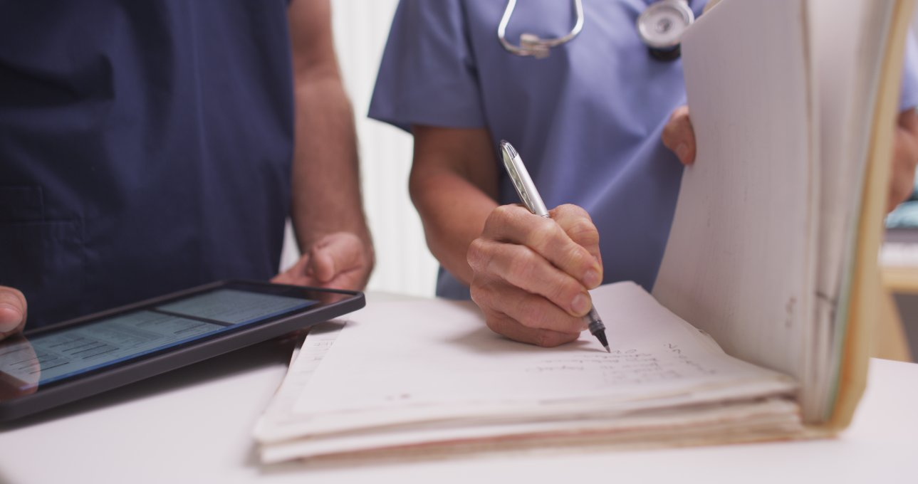 medical assistant writing down notes