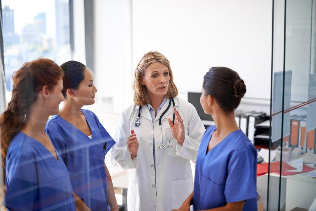 Doctor training Medical Assistants at externship.