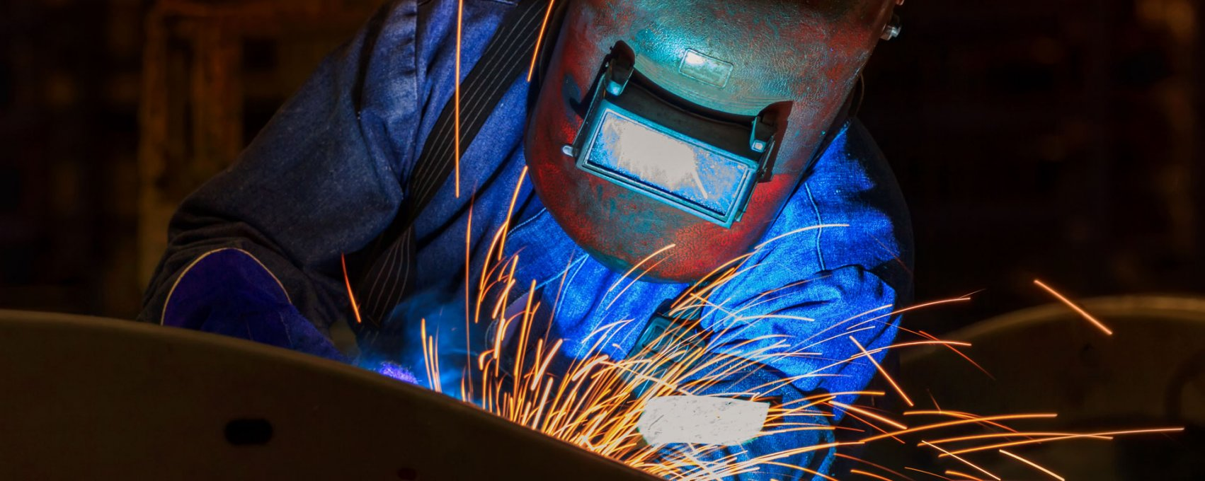 Man Practicing the safe operation of a welding torch
