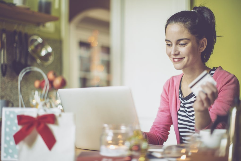 Woman Budgeting for Holiday Gifts