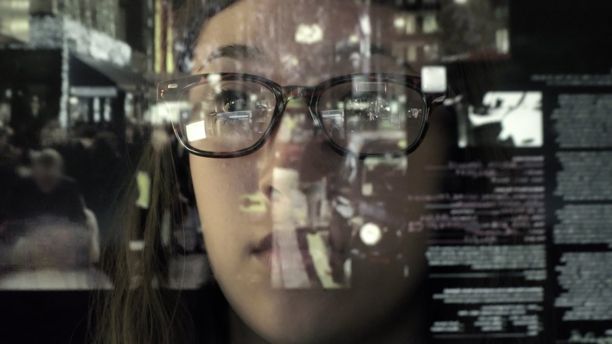 Young Woman Looking at New Technology in IT