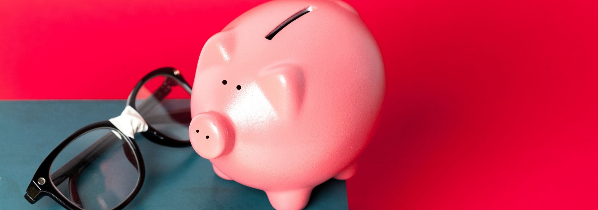 piggy bank and book to save money