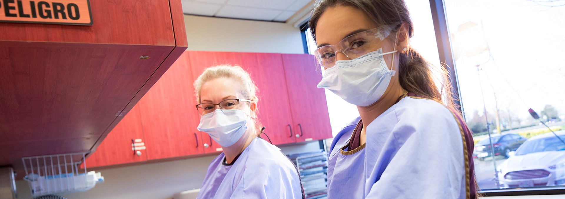 two dental students in the lab