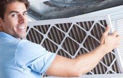 man preparing heating system for winter
